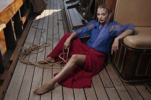 Trendy woman sitting on deck