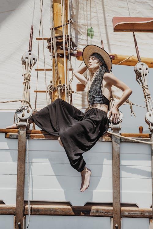 Stylish woman sitting on ship