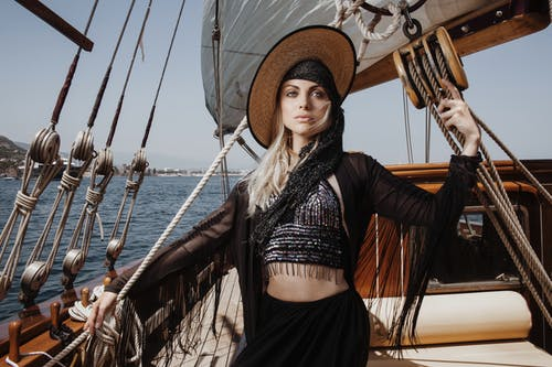 Stylish woman standing on deck