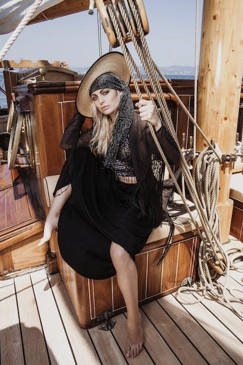 Woman in Black Dress Wearing Brown Straw Hat