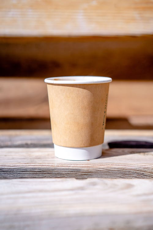 Brown and White Paper Cup on Wooden Table