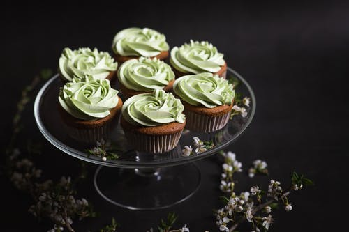 Green and Brown Cupcakes on Black Round Tray