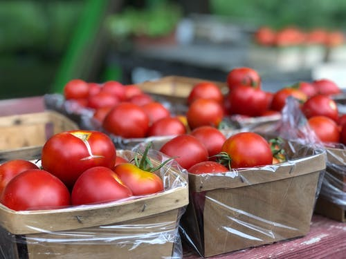 Red Tomatoes on Brown Wooden Crate