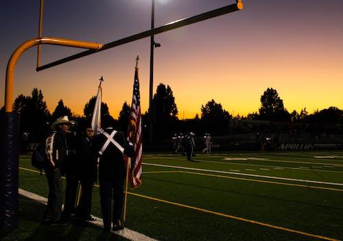 Kostenloses Stock Foto zu amerika, amerikanisch, amerikanische flagge, athleten