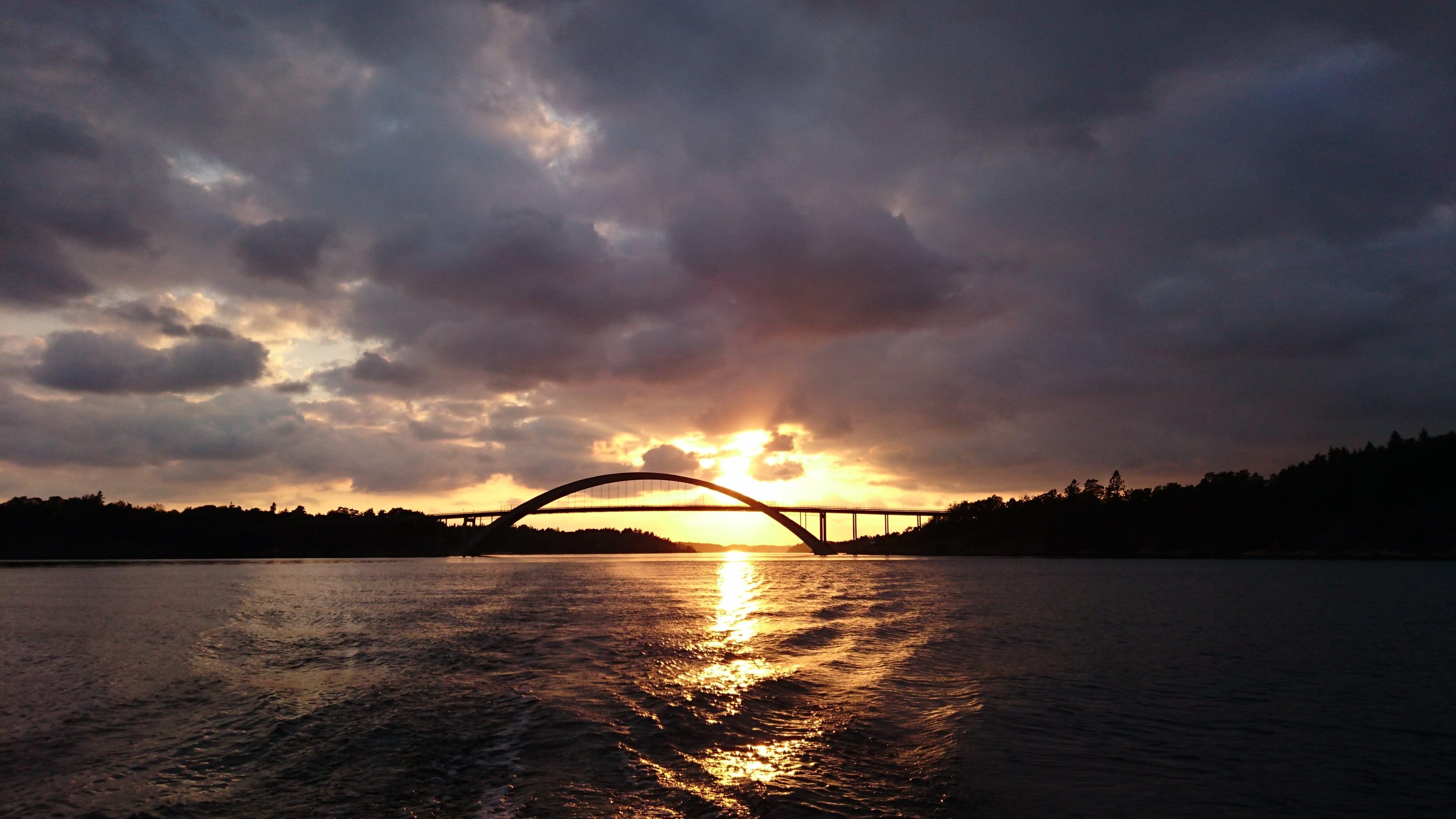 Free stock photo of arch bridge, Dark Sky, sunset, water