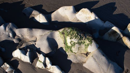 Gratis stockfoto met rotsen, schaduwen, stenen