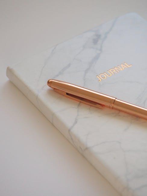 Gold pen on journal book