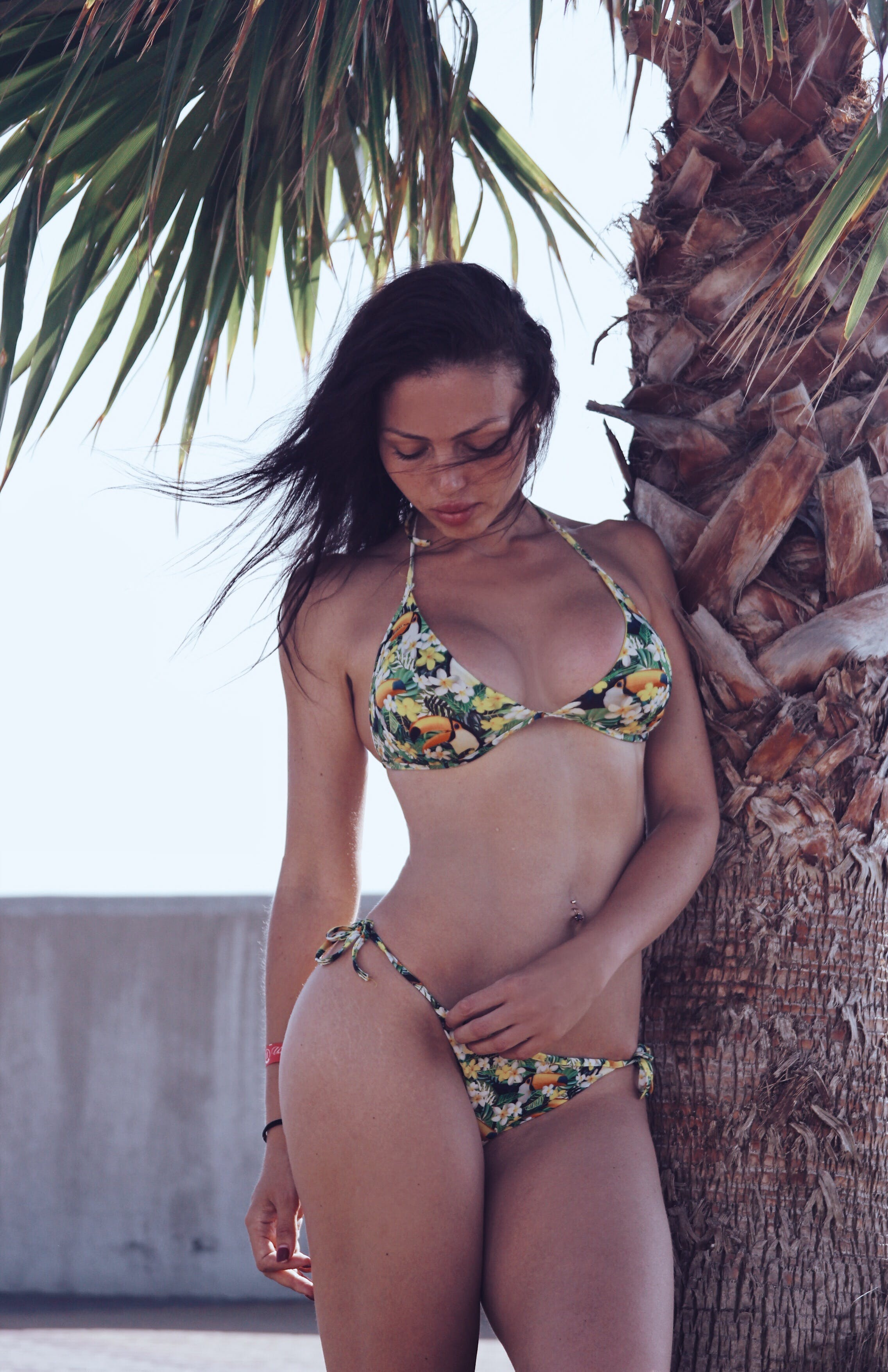 Black Haired Woman in Green and White Floral Print Bikini