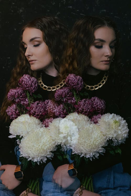 Double exposure of gentle stylish female with delicate bouquet of fresh chrysanthemum in blossom and eyes closed