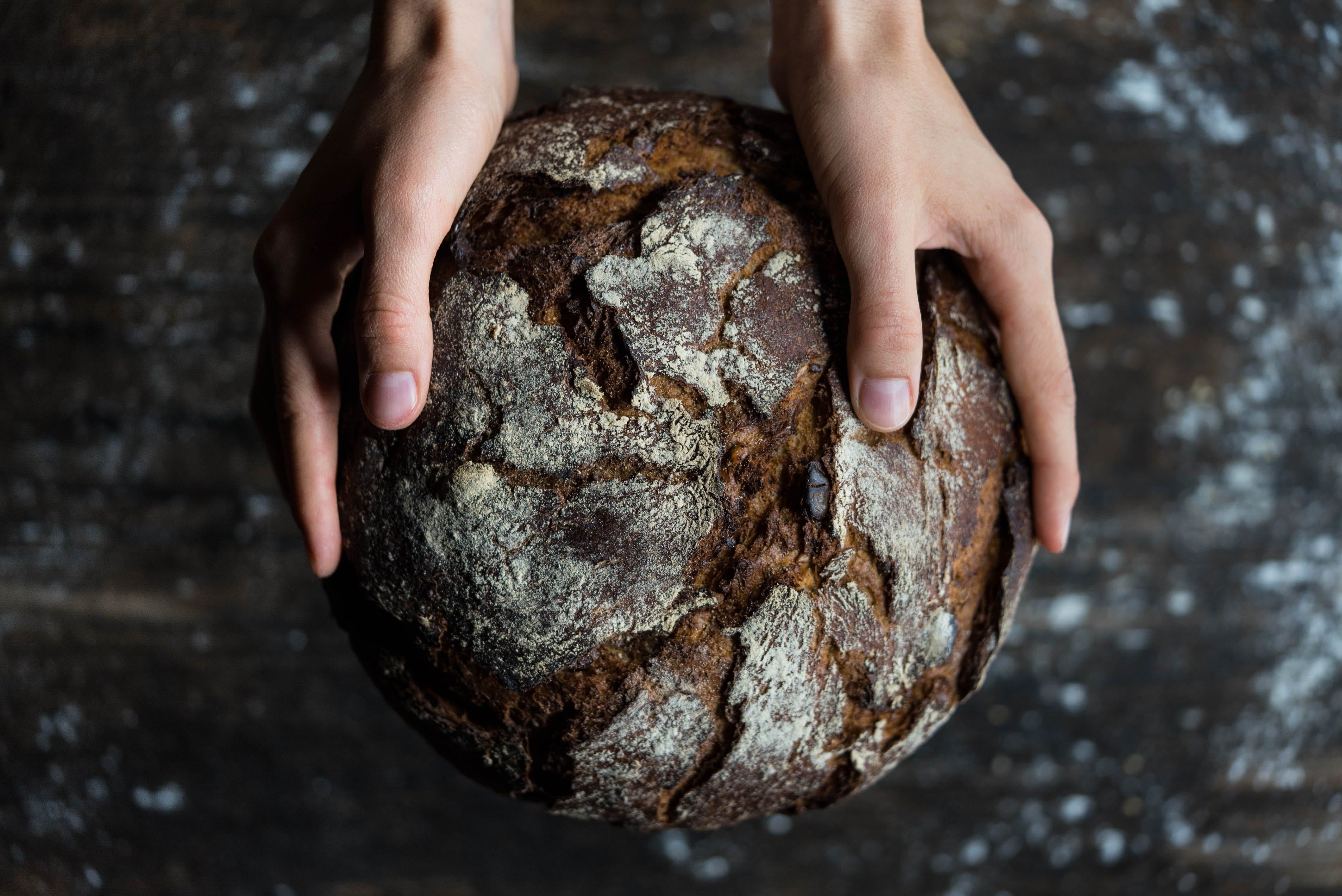 human holding a bread