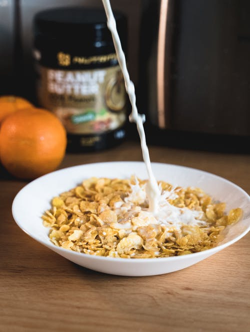White Ceramic Bowl With Cereals and Milk