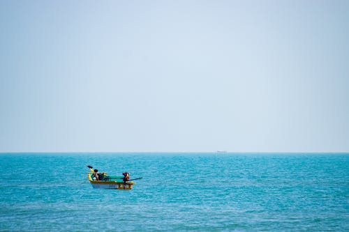 Man in Yellow Boat on Sea
