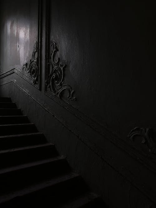 Staircase near wall with ornamental details