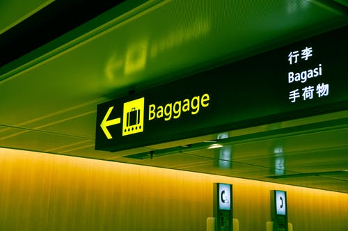 Close-up Photo of Baggage Sign