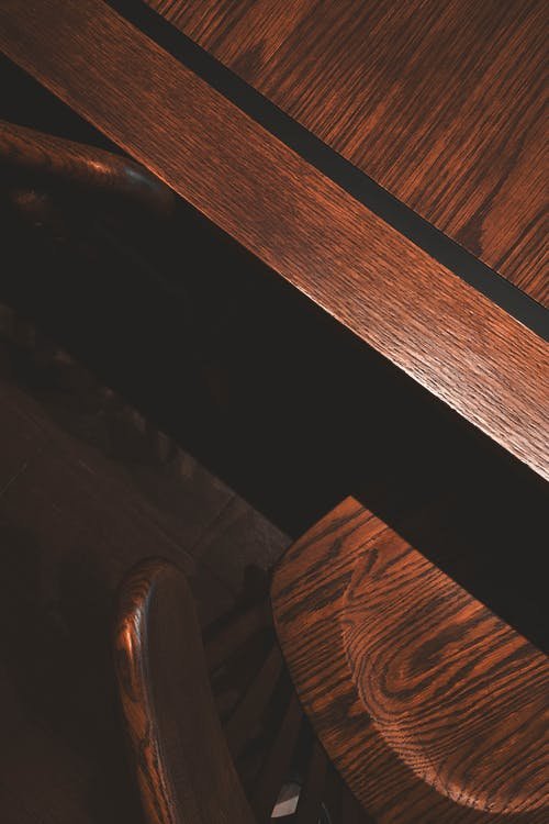 Brown Wooden Plank on Black Surface