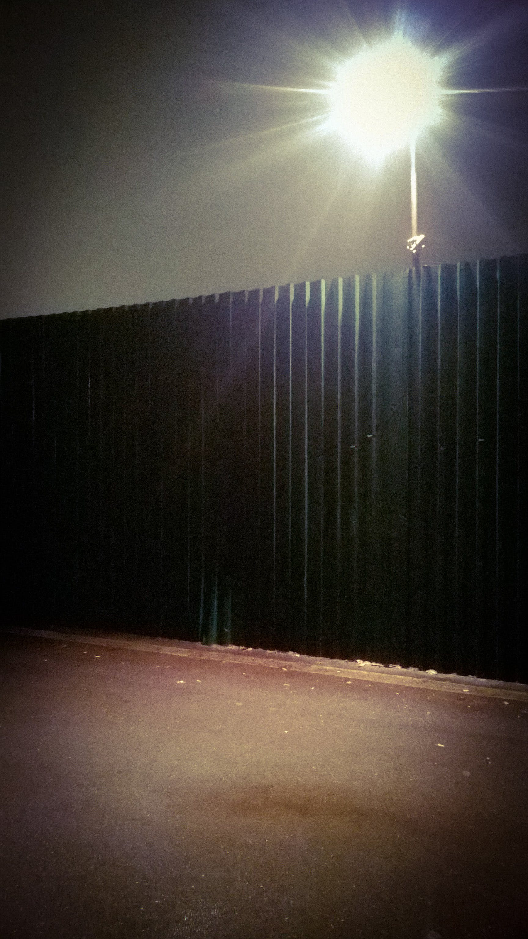 Black Fence Below Gray Light