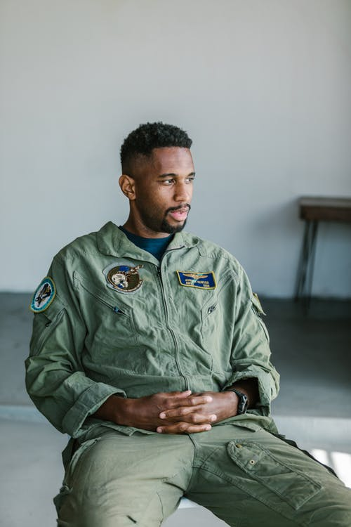 Photo of Soldier in Green Jumpsuit