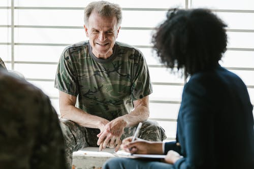 Photo of Soldier Smiling at the Therapist