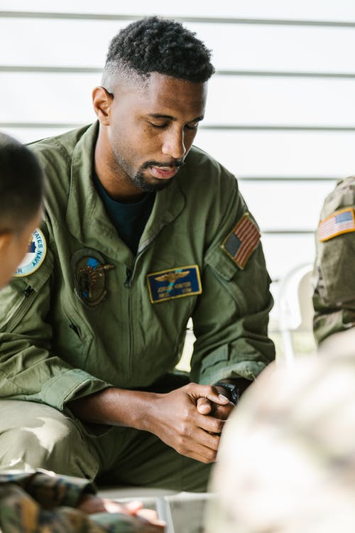 Photo of Soldier Praying with his Comrades