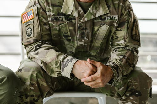 Photo of Person Wearing Military Uniform