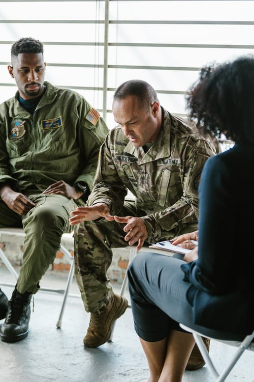 Photo of Soldier Looking Down while Talking