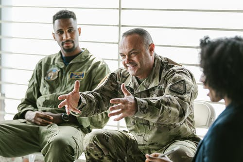 Photo of Men Wearing Military Uniform