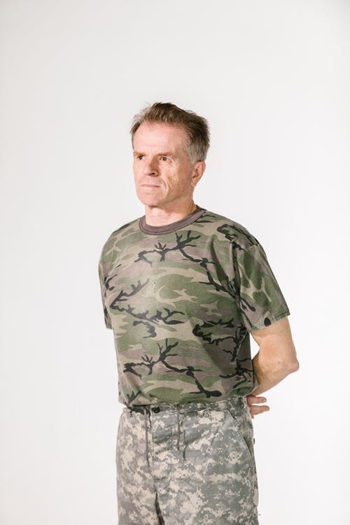 Photo of Soldier with his Arms Resting on the Back