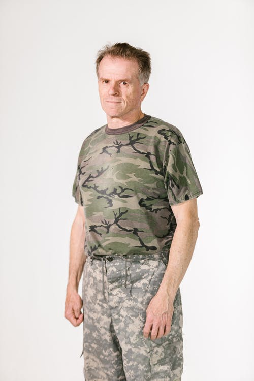 Medium Long Shot of a Soldier in a Studio