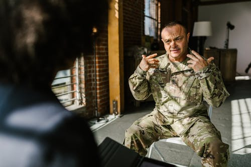 Photo of Soldier Explaining to a Therapist