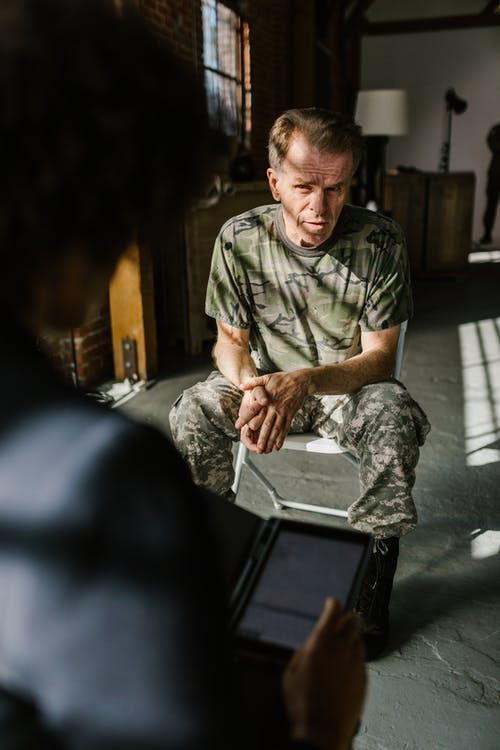 Photo of Soldier Listening to a Psychologist