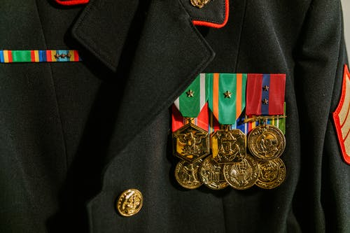 Close-Up Photo of Military Uniform with Medals