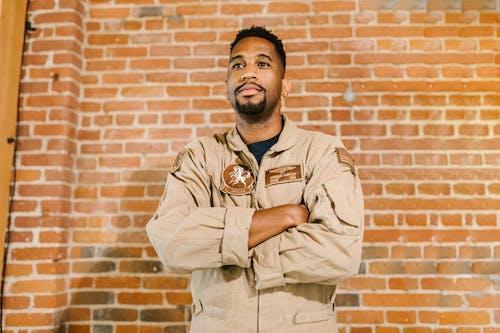 Photo of Soldier Wearing Beige MIlitary Uniform