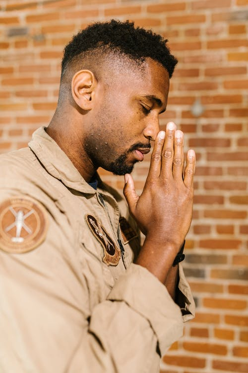 Side View Photo of Praying Soldier