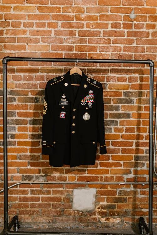 Photo of Black Blazer Hanging on a Clothing Rack