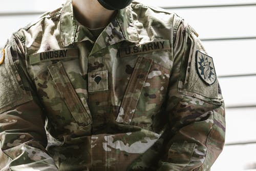 Close-Up Photo of Man Wearing Military Uniform