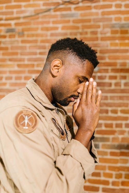 Side View Photo of Praying Man