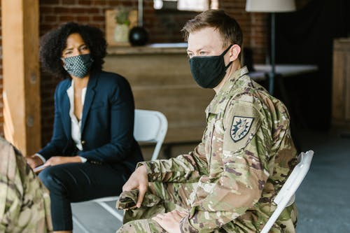 Photo of Man in Military Uniform Wearing Black Face Mask