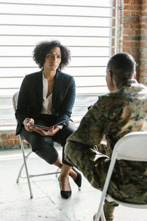 Photo of Psychologist Listening to a Soldier