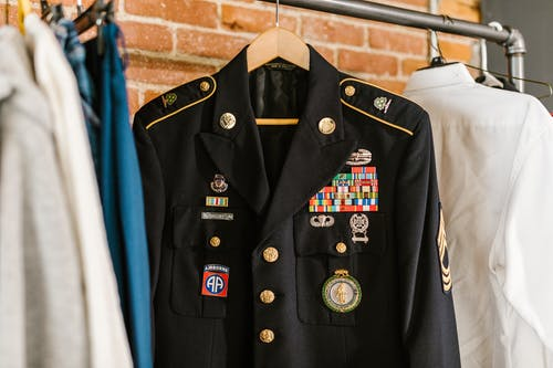 Photo of Military Uniform Hanging on a Rack