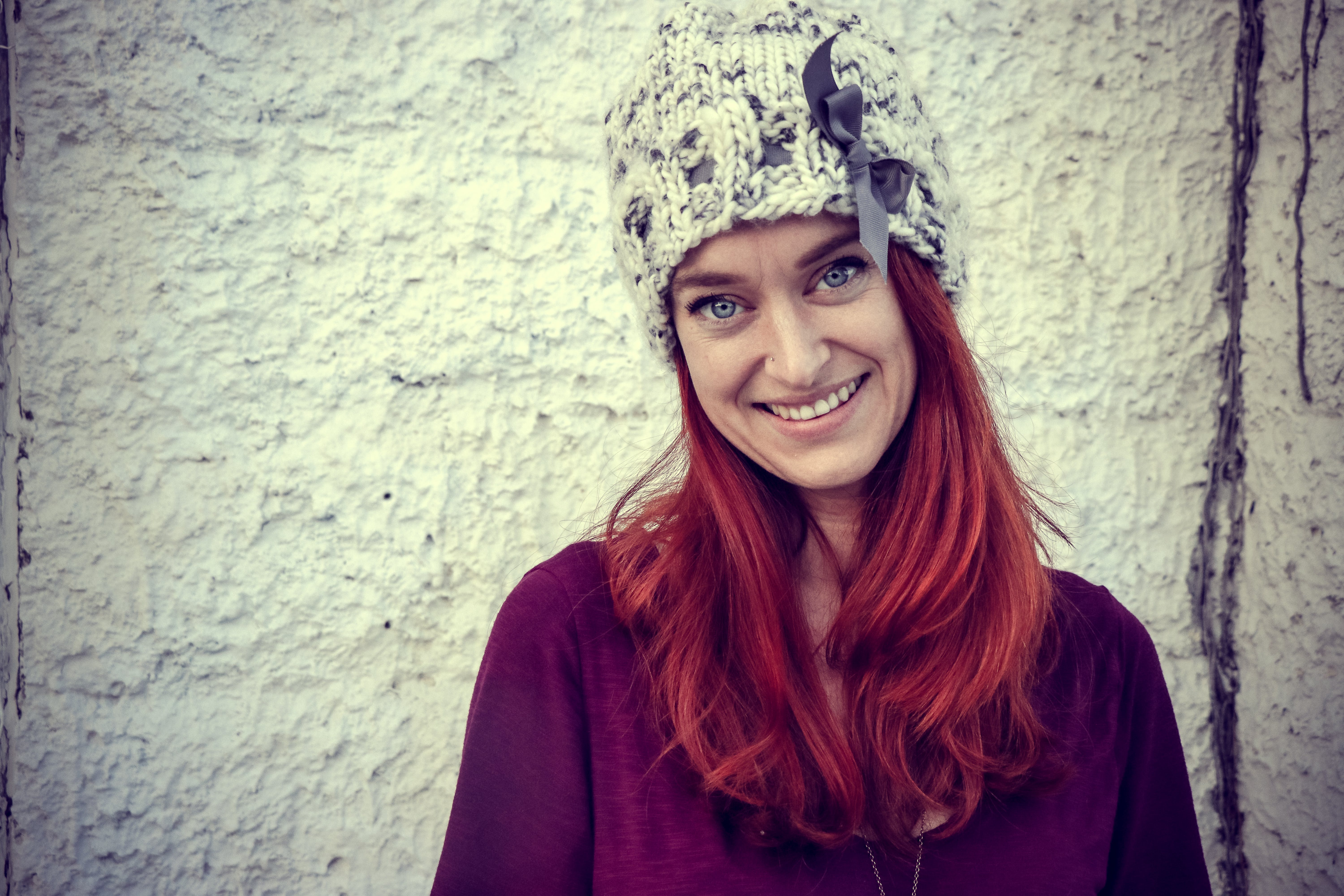 Woman With Red Hair Wears Purple Top