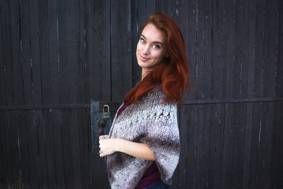 Woman Wearing Grey Printed Poncho Posing for Photo