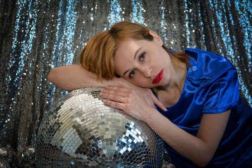 Attractive woman with decorative shining disco ball