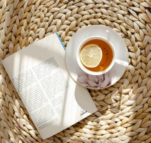 Book near cup of tea