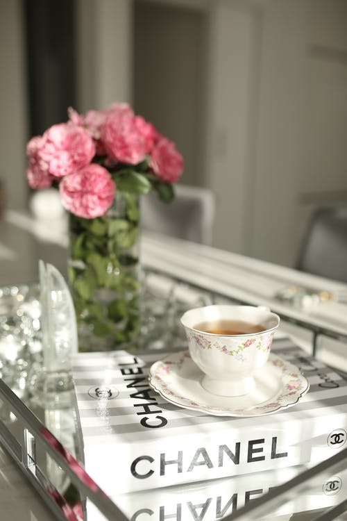 Roses on table near cup of tea