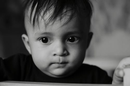 Grayscale Photo of a Cute Child