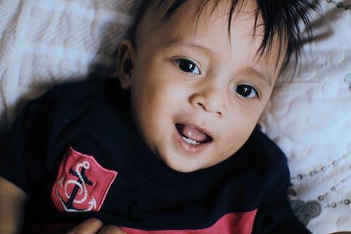 Close-Up Shot of a Cute Boy in Black Shirt