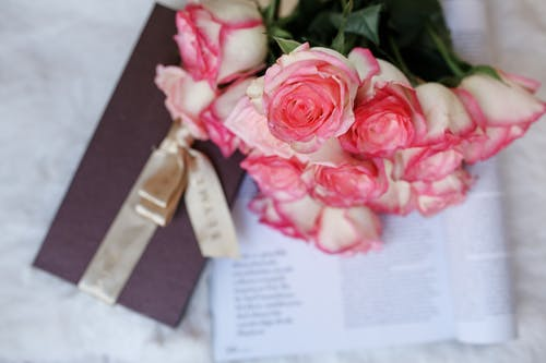 A Close-Up Shot of Bouquet of Pink and White Roses