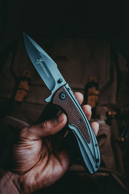 Close-Up Shot of a Person Holding a Blade Knife