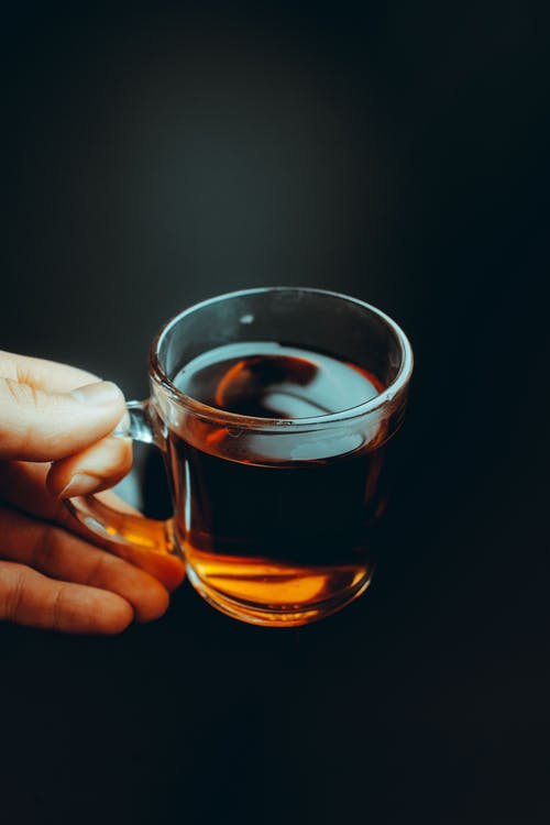 A Person Holding a Cup of Tea