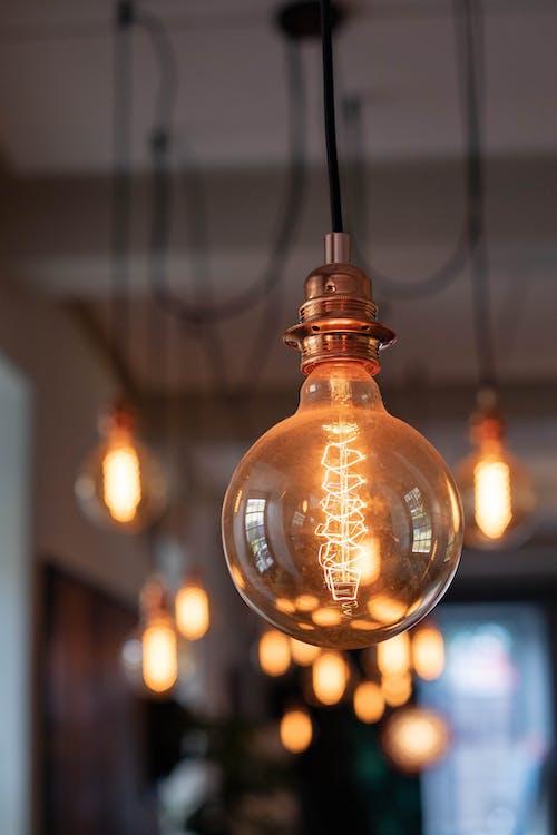 Bright vintage light bulb in cafe